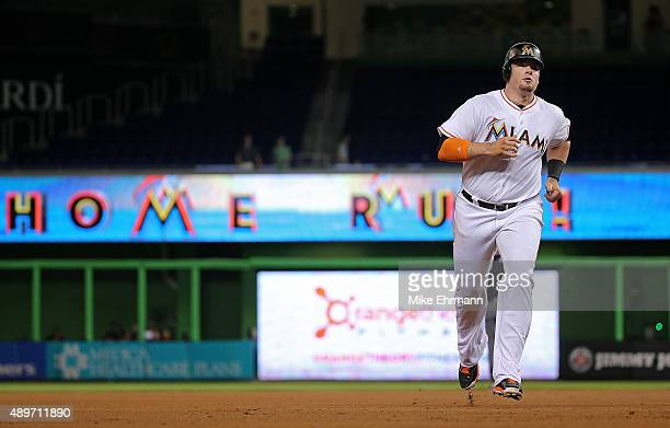 Justin Bour of the Miami Marlins rounds the bases after hitting a solo home run during a game against the Philadelphia Phillies at Marlins Park on...