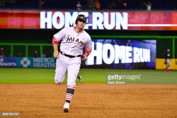 71a96cd6 Justin Bour of the Miami Marlins runs the bases after hitting a pinch hit  three run