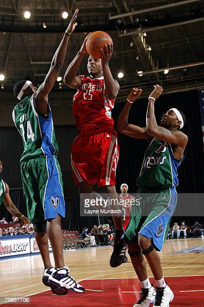 Justin Bowen of the Austin Toros shoots the ball between Ndudi Ebi and Jeremy Richardson of the Fort Worth Flyers during a DLeague game at the Fort...