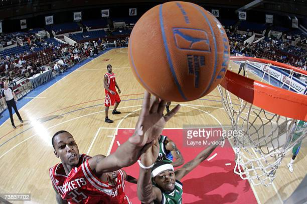 Justin Bowen of the Austin Toros shoots the ball over Jeremy Richardson of the Fort Worth Flyers during a DLeague game at the Fort Worth Convention...