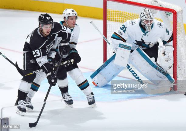 Justin Braun and Martin Jones of the San Jose Sharks defend against Dustin Brown of the Los Angeles Kings at STAPLES Center on November 12 2017 in...