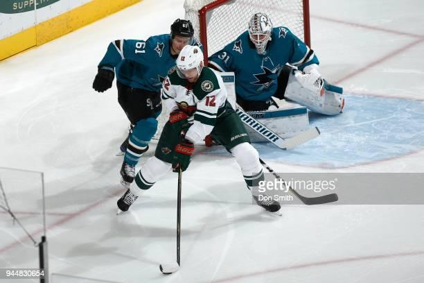 Justin Braun and Martin Jones of the San Jose Sharks defend Eric Staal of the Minnesota Wild at SAP Center on April 7 2018 in San Jose California...