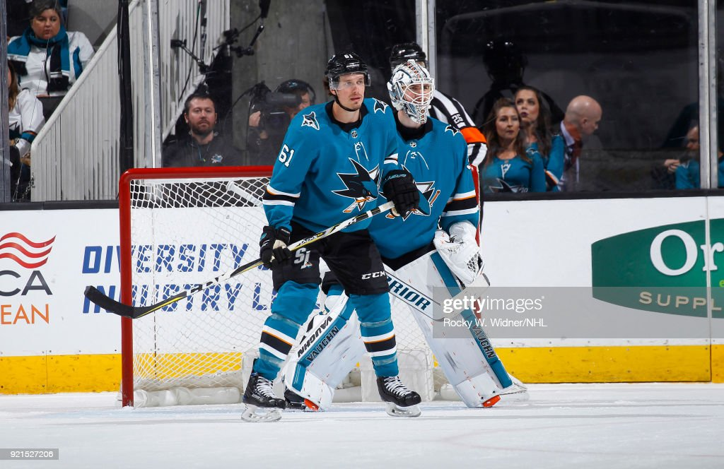 Justin Braun #61 and Martin Jones #31 of the San Jose Sharks defend the net against the Vancouver Canucks at SAP Center on February 15, 2018 in San Jose, California.