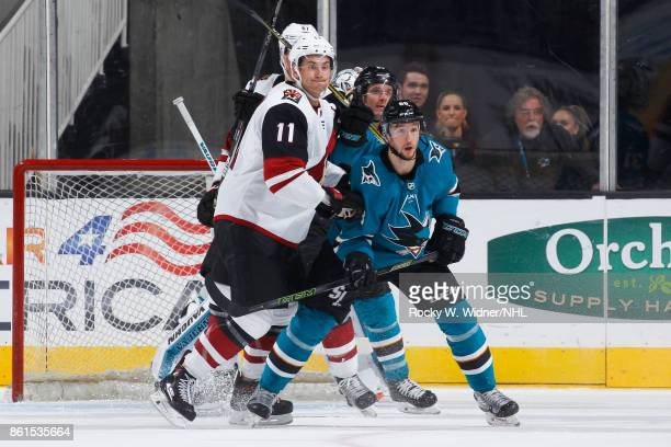 Justin Braun and Melker Karlsson of the San Jose Sharks defend against Brendan Perlini and Lawson Crouse of the Arizona Coyotes at SAP Center at San...