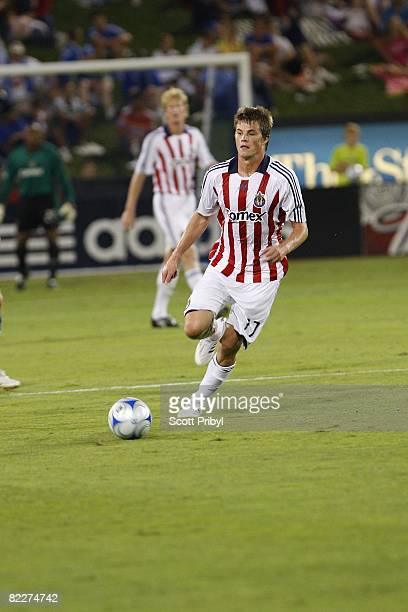Justin Braun of Chivas USA dribbles the ball against the Kansas City Wizards during the game at Community America Ballpark on August 9 2008 in Kansas...