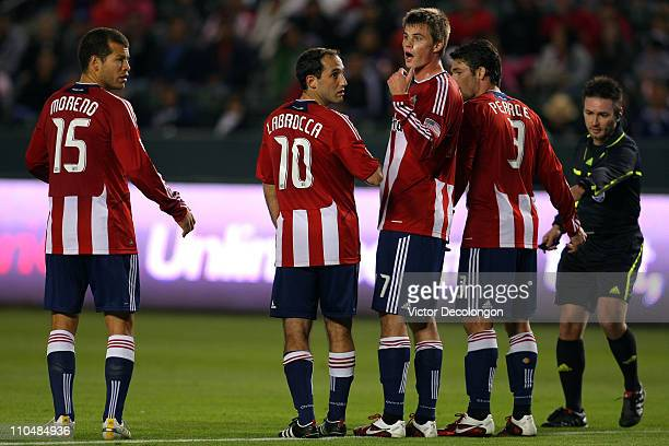 Justin Braun of Chivas USA helps to organize the defensive wall before a free kick by Sporting Kansas City in the second half during the MLS match at...