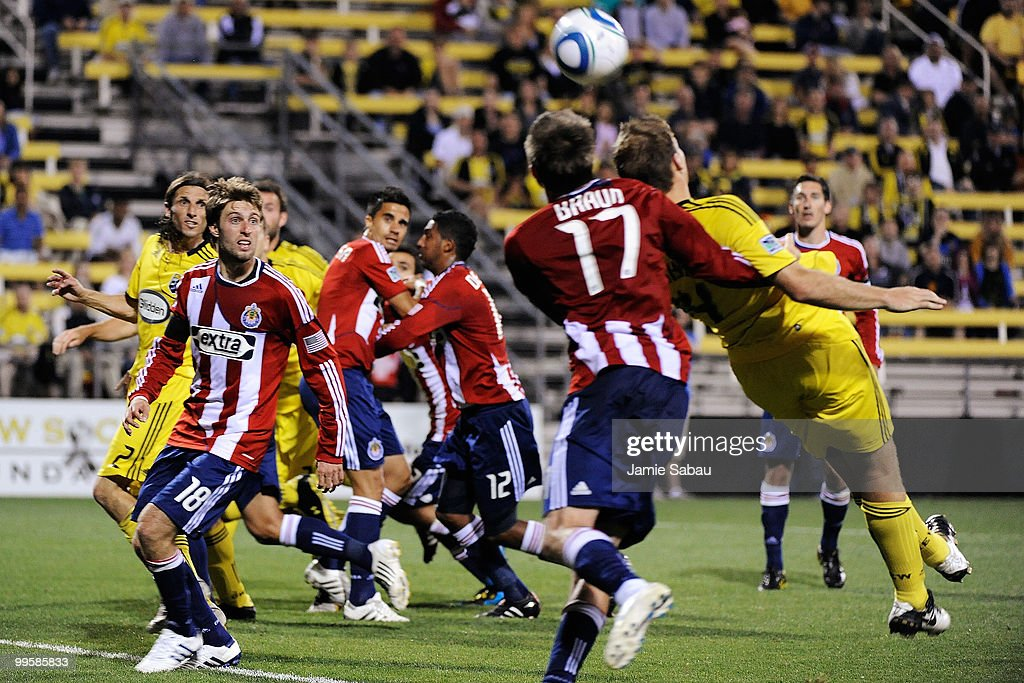Justin Braun #17 of Chivas USA pulls down Chad Marshall #14 of the Columbus Crew in the box resulting in a penalty kick for the Crew on May 15, 2010 at Crew Stadium in Columbus, Ohio. The Crew defeated Chivas USA