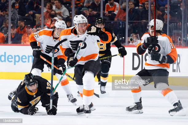 Justin Braun of the Philadelphia Flyers chases the puck against the Boston Bruins at Wells Fargo Center on October 20, 2021 in Philadelphia,...
