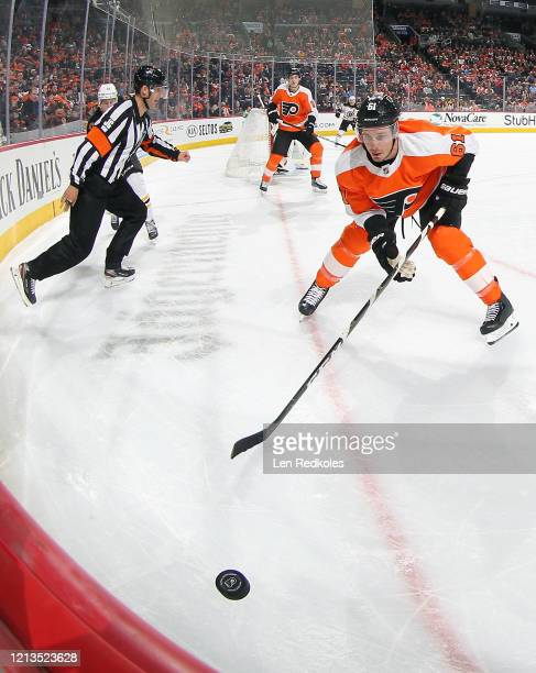 Justin Braun of the Philadelphia Flyers plays the puck in the corner against the Boston Bruins on March 10 2020 at the Wells Fargo Center in...