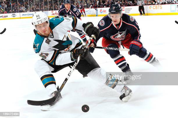 Justin Braun of the San Jose Sharks and Mark Letestu of the Columbus Blue Jackets chase after a loose puck during the third period on February 21,...