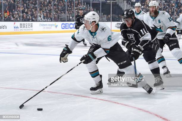 Justin Braun of the San Jose Sharks handles the puck against Anze Kopitar of the Los Angeles Kings at STAPLES Center on January 15 2018 in Los...