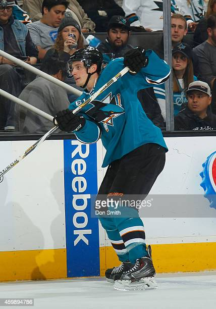 Justin Braun of the San Jose Sharks passes the puck against the Anaheim Ducks during an NHL game on November 29, 2014 at SAP Center in San Jose,...