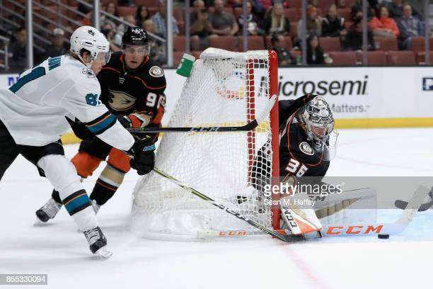 Justin Braun of the San Jose Sharks shoots on goal as Giovanni Fiore and John Gibson of the Anaheim Ducks defend during the second period of a...