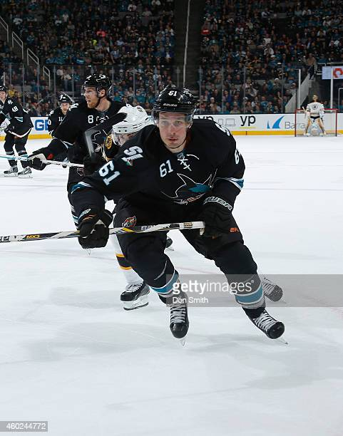 Justin Braun of the San Jose Sharks skates after the puck against the Boston Bruins during an NHL game on December 4, 2014 at SAP Center in San Jose,...