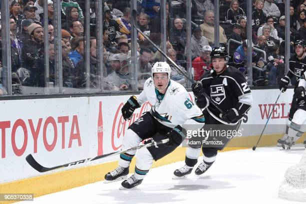 Justin Braun of the San Jose Sharks skates against Dustin Brown of the Los Angeles Kings during a game at STAPLES Center on January 15 2018 in Los...