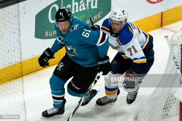 Justin Braun of the San Jose Sharks skates against Vladimir Sobotka of the St Louis Blues at SAP Center on March 8 2018 in San Jose California