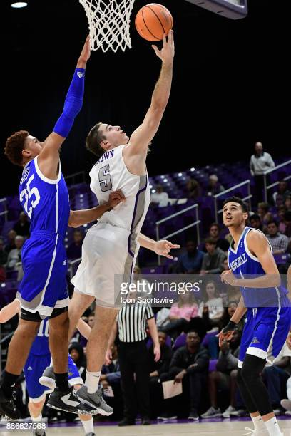Justin Brown guard UNC Asheville Bulldogs shoots for two against MaCio Teague guard UNC Asheville Bulldogs Tuesday December 5 at Timmons Arena in...