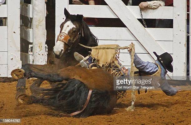 Justin Browning hits the dirt with Mary Jane during his saddle bronc ride at Fort Worth Stock Show Rodeo January 27 in Fort Worth Texas There is...