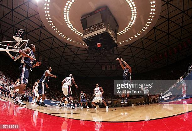 Justin Cage of the Xavier Musketeers shoots a 3point shot against Pierre Marie AltidorCesedes of the Gonzaga Bulldogs during the First Round of the...