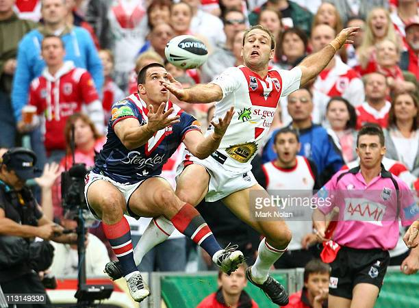Justin Carney of the Roosters and Jason Nightingale of the Dragons contest a high ball during the round seven NRL match between the Sydney Roosters...