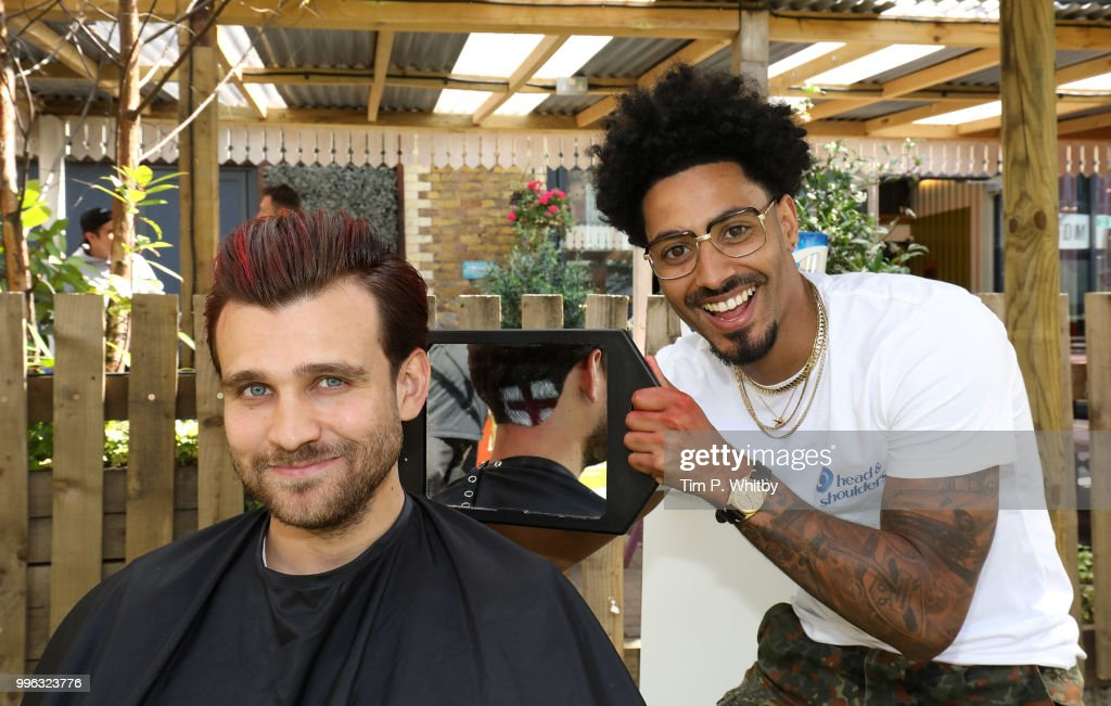 Justin Carr, England's World Cup barber, gets fans ready for tonight's match as they go Scalp Brave with Head & Shoulders at Flat Iron Square on July 11, 2018 in London, England.