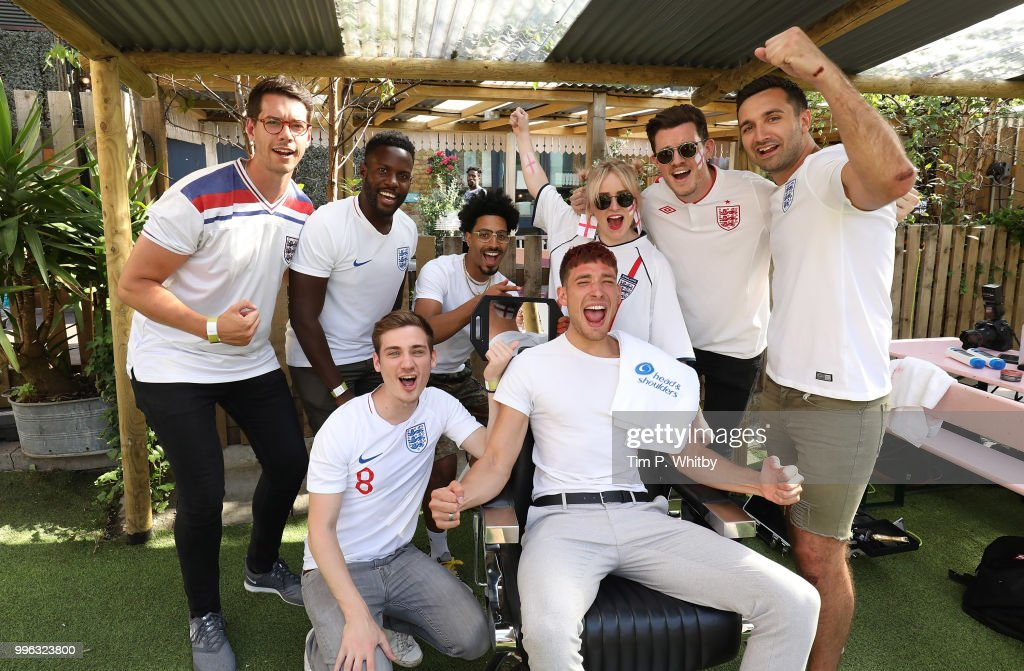 Justin Carr (centre with mirror), England's World Cup barber, gets fans ready for tonight's match as they go Scalp Brave with Head & Shoulders at Flat Iron Square on July 11, 2018 in London, England.