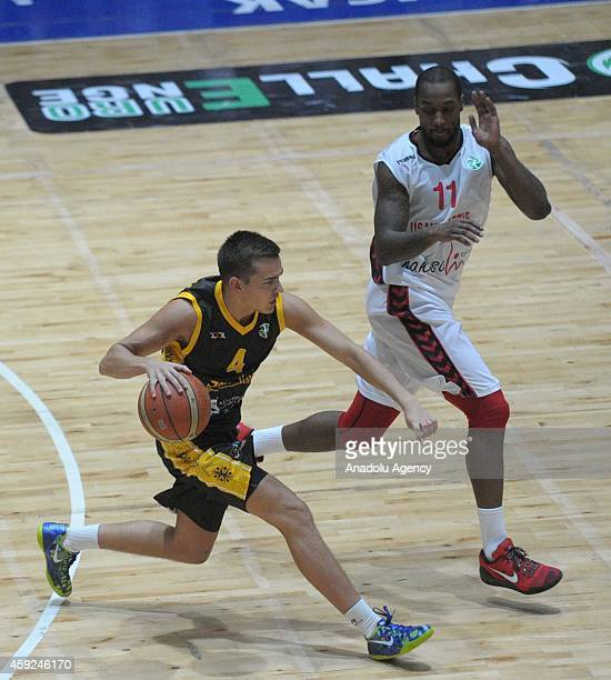 Justin Carter of Usak Sportif vies with Karolis Babkauskas of BC Siauliai during FIBA EuroChallenge Group H basketball match between Usak Sportif and...