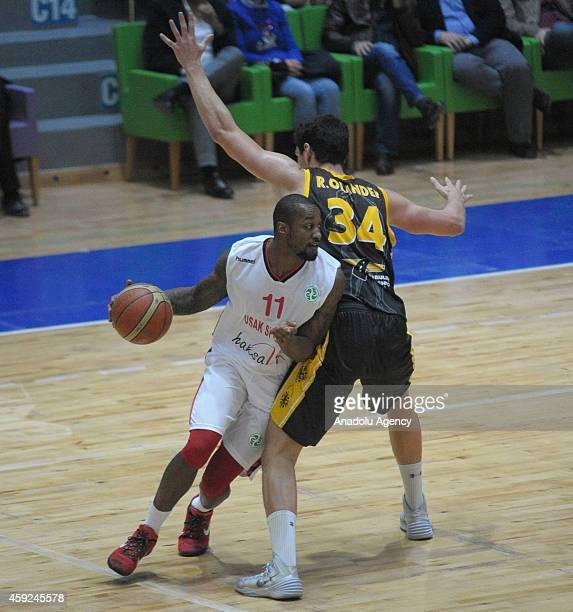 Justin Carter of Usak Sportif vies with Ryan Olander of BC Siauliai during FIBA EuroChallenge Group H basketball match between Usak Sportif and BC...