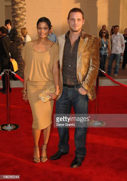 Justin Chambers and guest during 2006 American Music Awards Arrivals at Shrine Auditorium in Los Angeles California United States