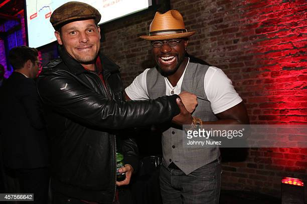 Justin Chambers and Taye Diggs attend the Ford and Hard Rock Hotels Casinos event The Mustang Roadhouse on Monday October 20 2014 in New York City...
