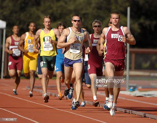 Justin Chambers of Washington State and Blake Bidleman of Washington lead the decathlon 1500 meters in the Pacific10 Conference Track Field...