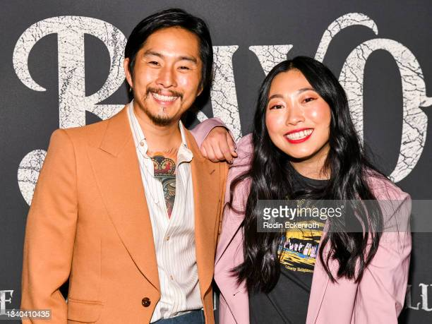"""Justin Chon and Awkwafina attend the Los Angeles Premiere of Focus Features' """"Blue Bayou"""" at DGA Theater Complex on September 14, 2021 in Los..."""