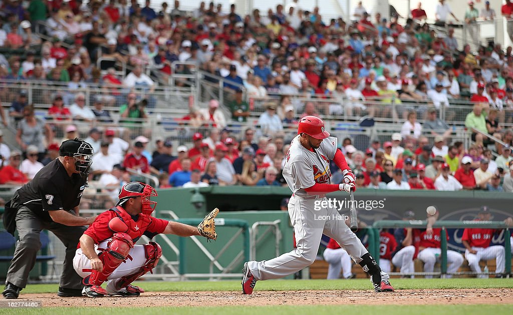 Justin Christian #60 of the St. Louis Cardinals doubles to left field in the six inning during the game against the Boston Red Sox at JetBlue Park on February 26, 2013 in Fort Myers, Florida.