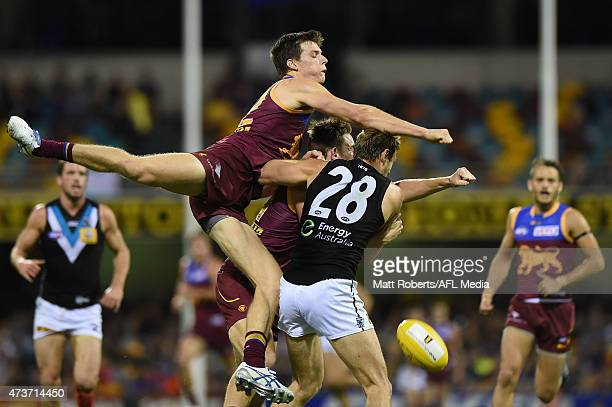 Justin Clarke of the Lions spoils the mark during the round seven AFL match between the Brisbane Lions and the Port Adelaide Power at The Gabba on...