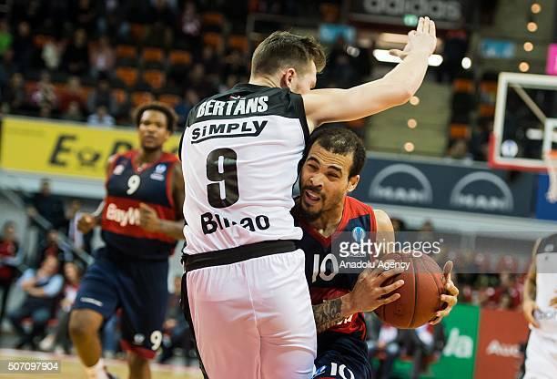 Justin Cobbs of Bayern Munich in an action against Dairis Bertans of Bilbao during the ULEB Eurocup Basketball match between Bayern Munich and Bilbao...