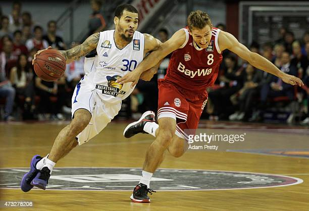 Justin Cobbs of Fraport is challenged by Heiko Schaffartzik of Muenchen during the Basketball Play Offs between Bayern Muenchen and Fraport Skyliners...