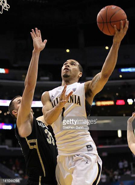 Justin Cobbs of the California Golden Bears goes up for a shot against Austin Dufault of the Colorado Buffaloes in the second half in the semifinals...