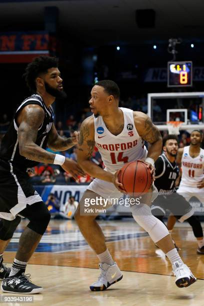 Justin Cousin of the Radford Highlanders is defended by Joel Hernandez of the LIU Brooklyn Blackbirds during the game at UD Arena on March 13 2018 in...