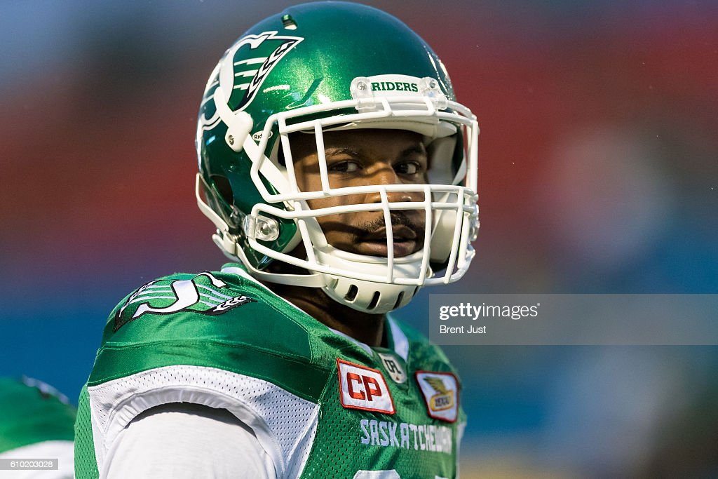 Justin Cox #31 of the Saskatchewan Roughriders on the field for pre-game warmup for the game between the Hamilton Tiger-Cats and Saskatchewan Roughriders at Mosaic Stadium on September 24, 2016 in Regina, Canada.