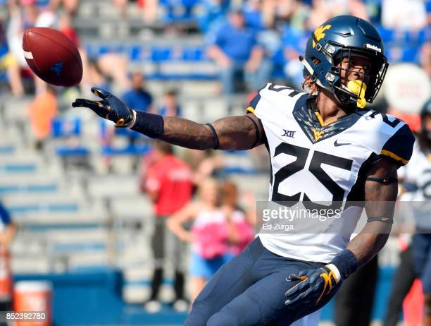 Justin Crawford of the West Virginia Mountaineers tosses the ball as he celebrates his second quarter touchdown against the Kansas Jayhawks at...