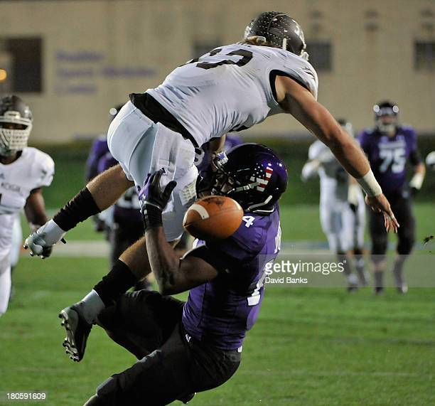 Justin Currie of the Western Michigan Broncos breaks up a pass to Christian Jones of the Northwestern Wildcats during the first quarter on September...