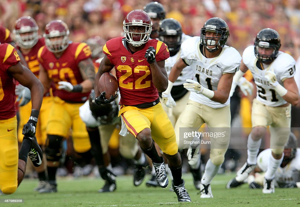Justin Davis #22 of the USC Trojans carries on a 43 yard running play to set up up the Trojans' second touchdown in the first quarter against the Idaho Vandals at Los Angeles Memorial Coliseum on September 12, 2015 in Los Angeles, California.