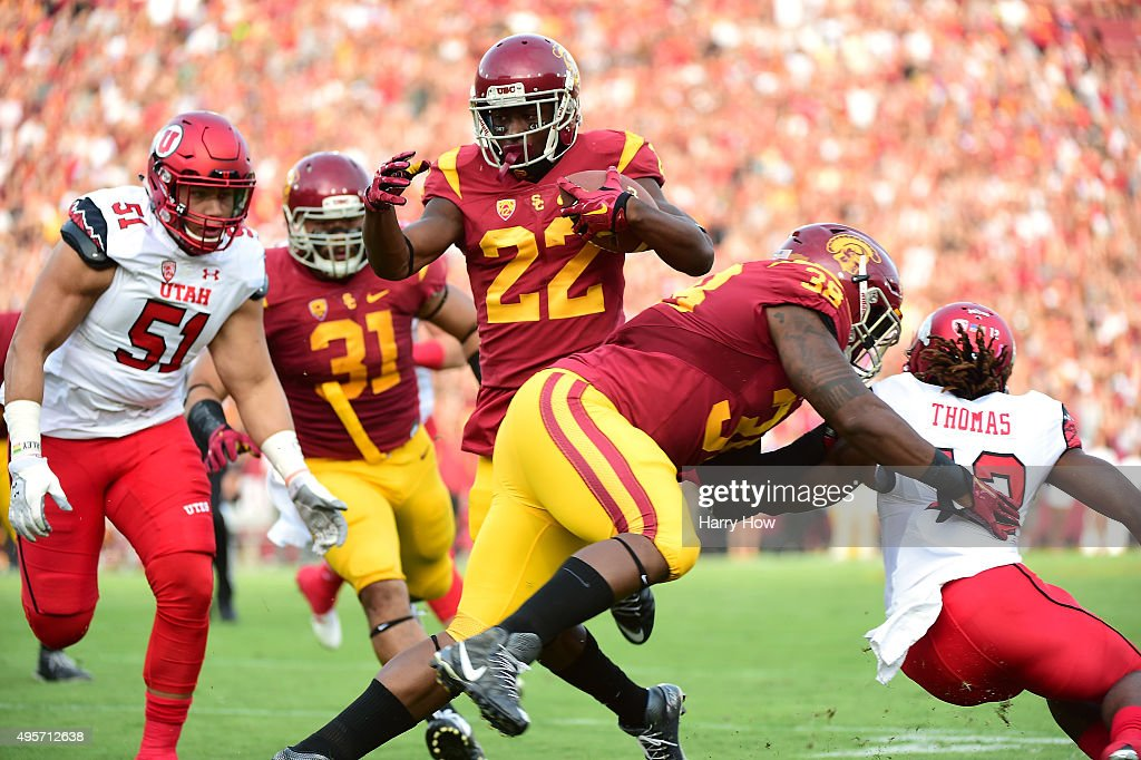 Justin Davis #22 of the USC Trojans carries the ball against the Utah Utes at Los Angeles Memorial Coliseum on October 24, 2015 in Los Angeles, California.