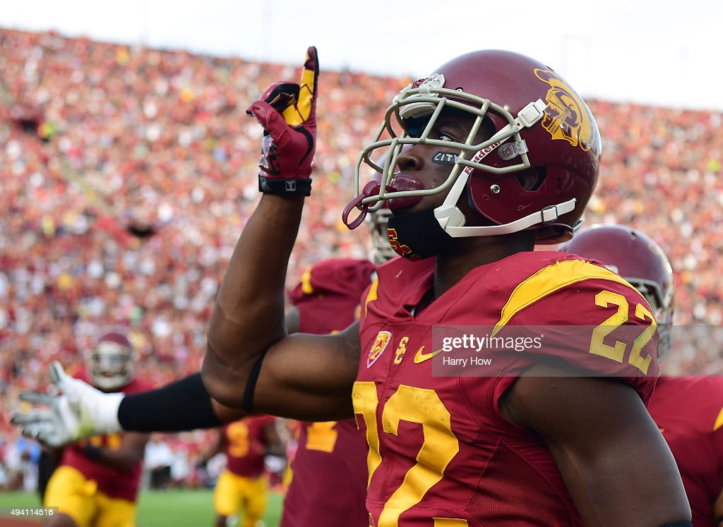 Justin Davis #22 of the USC Trojans celebrates a touchdown against the Utah Utes to take a 7-0 lead during the first quarter at Los Angeles Memorial Coliseum on October 24, 2015 in Los Angeles, California.