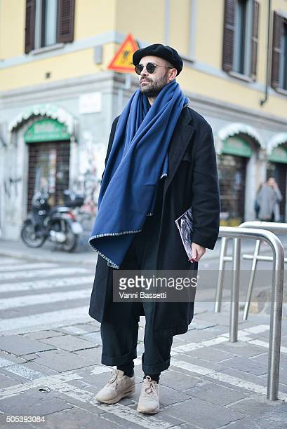 Justin Dean poses wearing a Comme des Garcons coat and Nike shoesafter the Missoni show during the Milan Men's Fashion Week Fall/Winter 2016/17 on...