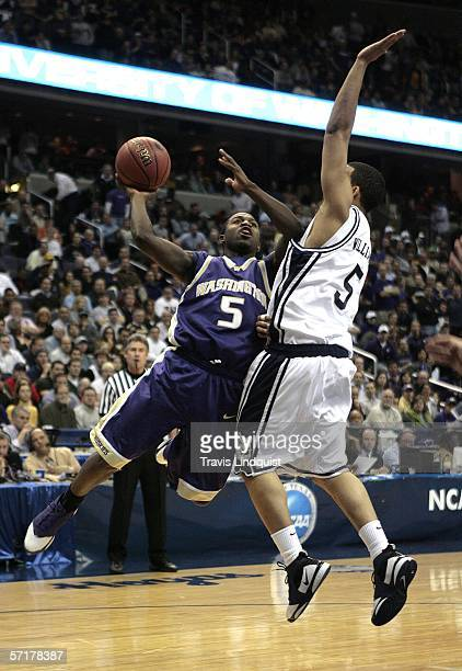 Justin Dentmon of the Washington Huskies shoots against Marcus Williams of the Connecticut Huskies during the Regionals of the NCAA Men's Basketball...