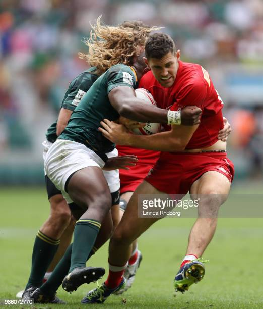 Justin Douglas of Canada and Werner Kok of South Africa in action in their Pool D match during the HSBC London Sevens at Twickenham Stadium on June 2...