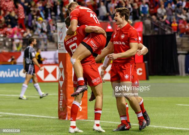 Justin Douglas of Canada congratulated by Harry Jones and the Canadian team during Game Canada vs Uruguay Pool A match at the Canada Sevens held...