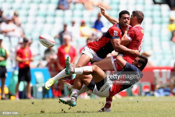 Justin Douglas of Canada is tackled during the Challenge Trophy Quarter Final match between Canada and Japan in the 2017 HSBC Sydney Sevens at...