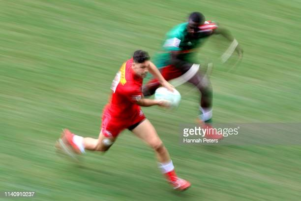 Justin Douglas of Canada looks to pass the ball out against Canada on day three of the Cathay Pacific/HSBC Hong Kong Sevens at the Hong Kong Stadium...